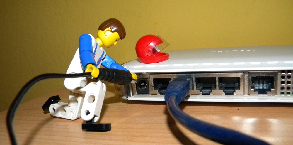 A manikin working on a router