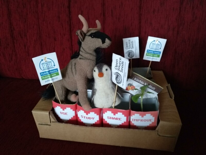 A picture by Sonja who grows open source seeds, decorated with FSFE stickers, a GNU and a Tux