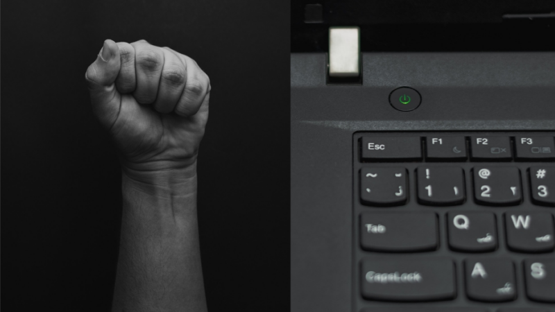 Protest fist and a computer